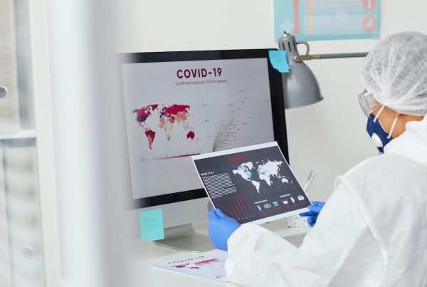 Doctor looking at Coronavirus statistics